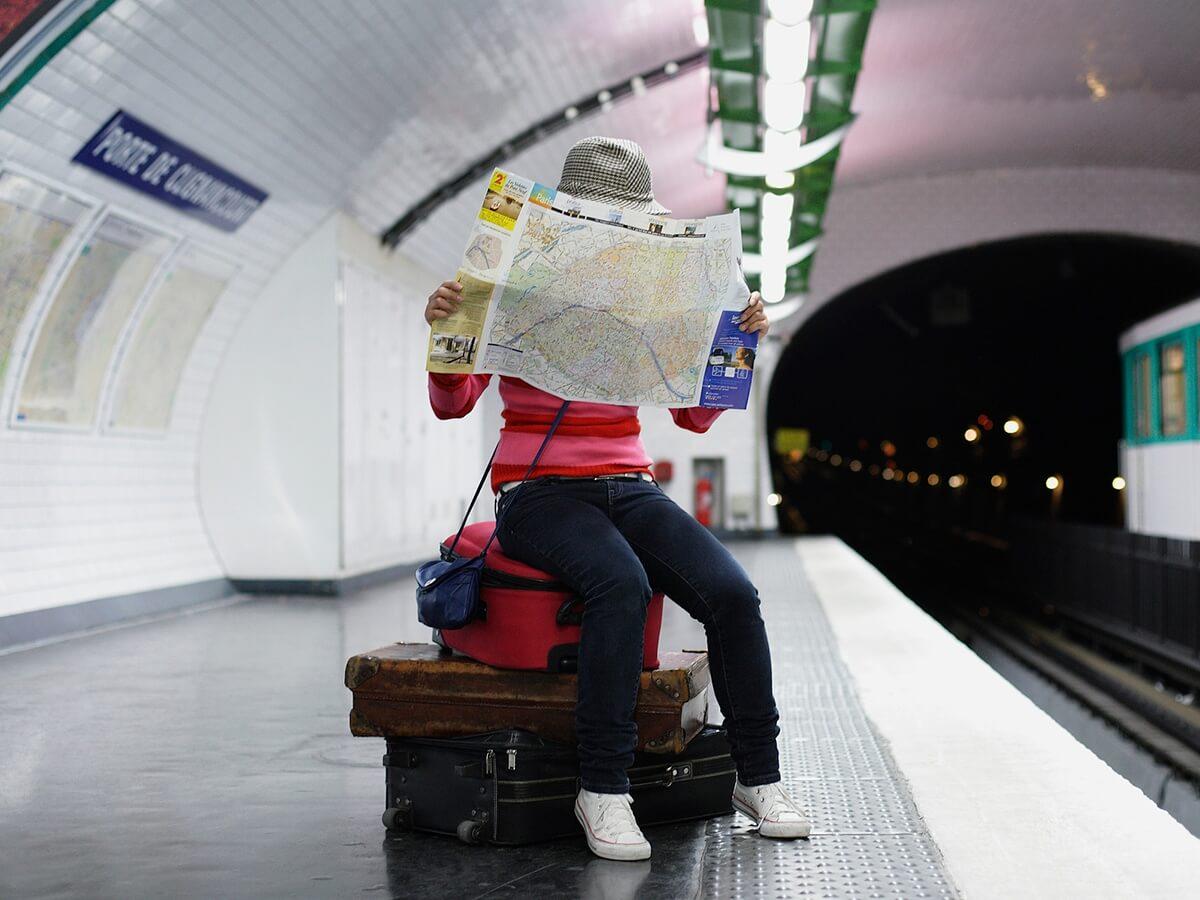 Man Reading Map At Train Station